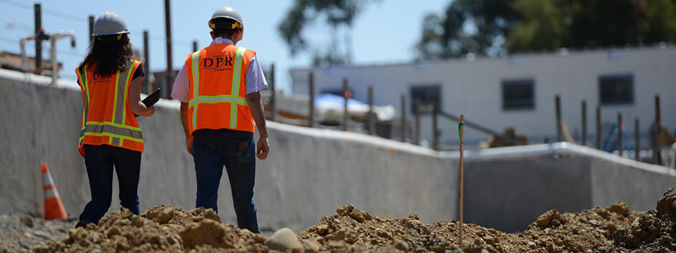 Employees walk a jobsite.