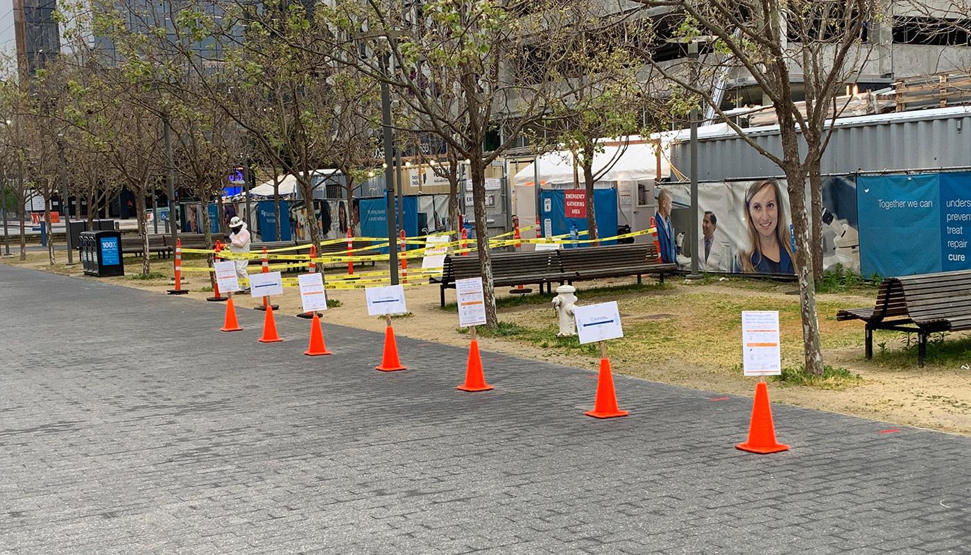 Cones and signage are set up outside the UCSF Block 23A site to remind people of social distancing requirements.