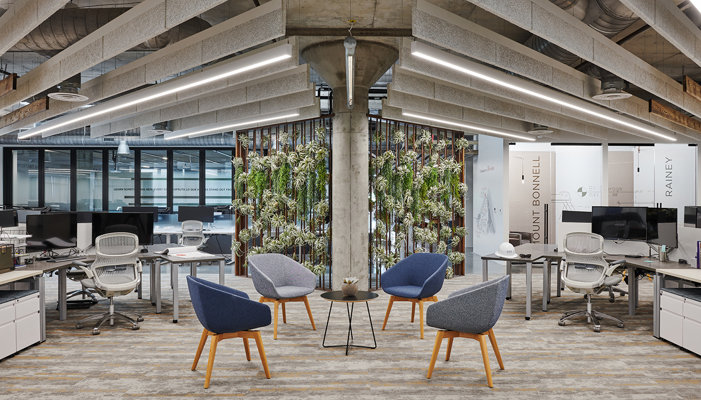 Living wall inside of DPR's Austin office space, surrounded by chairs and desks.