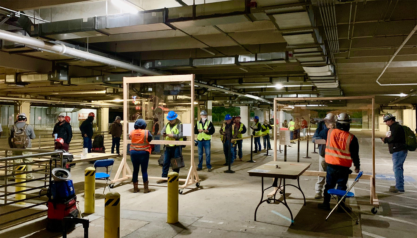 DPR Construction employees are screened for symptoms of COVID-19 prior to entering the Hilton Americas jobsite.