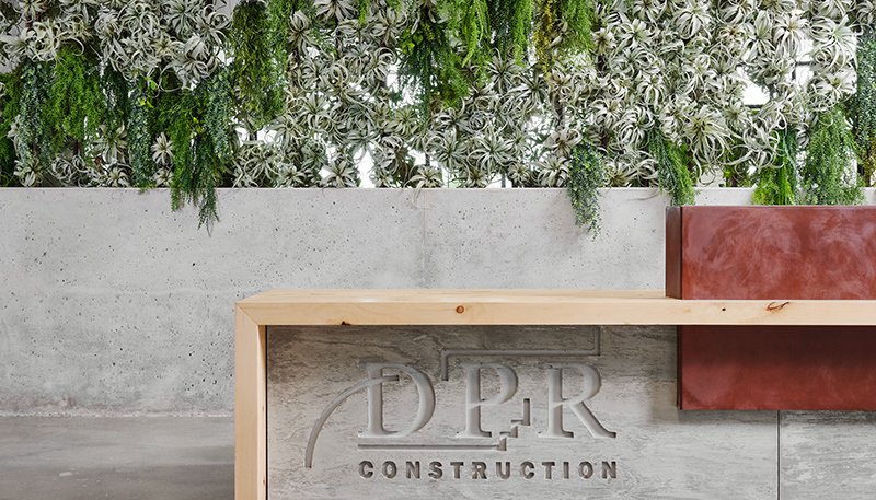 Living wall behind a DPR sign in the Austin office.