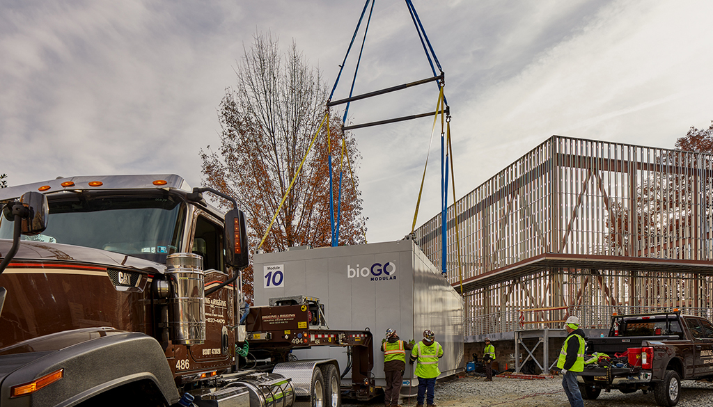 The DPR team prepares a modular unit to be hoisted into the NIH structure.