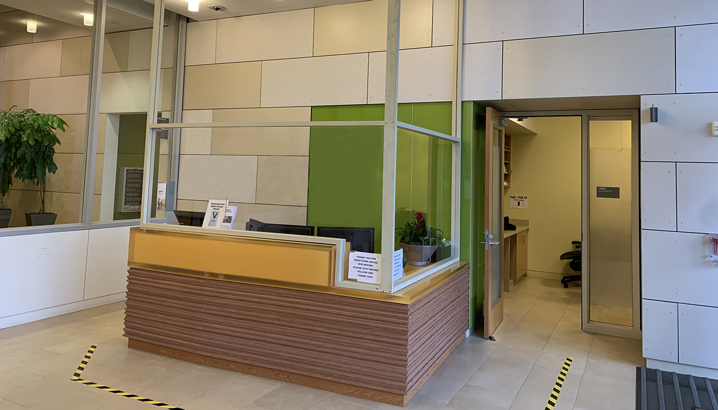 A safety screen and floor tape to encourage physical distancing have were added to this customer's reception area.