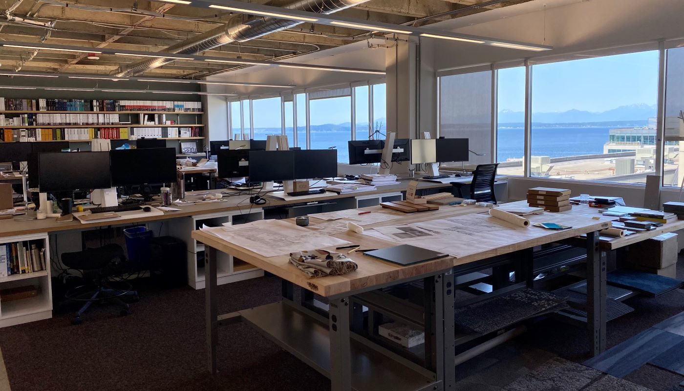 Interior workspace and desks at the WRNS Studio Office with views of Elliott Bay
