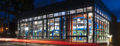 A view of the the building showing colorful pipes and ductwork because of the utility plant's design.