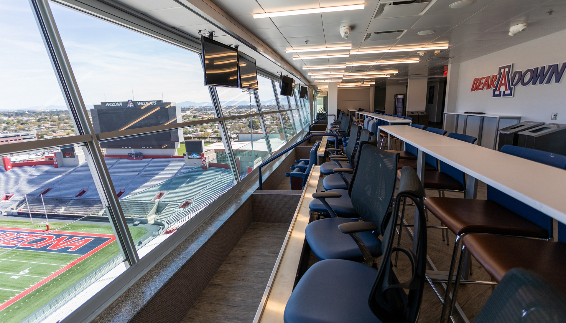 A view of the renovated presidential suite at Arizona Stadium with the football field in clear view.