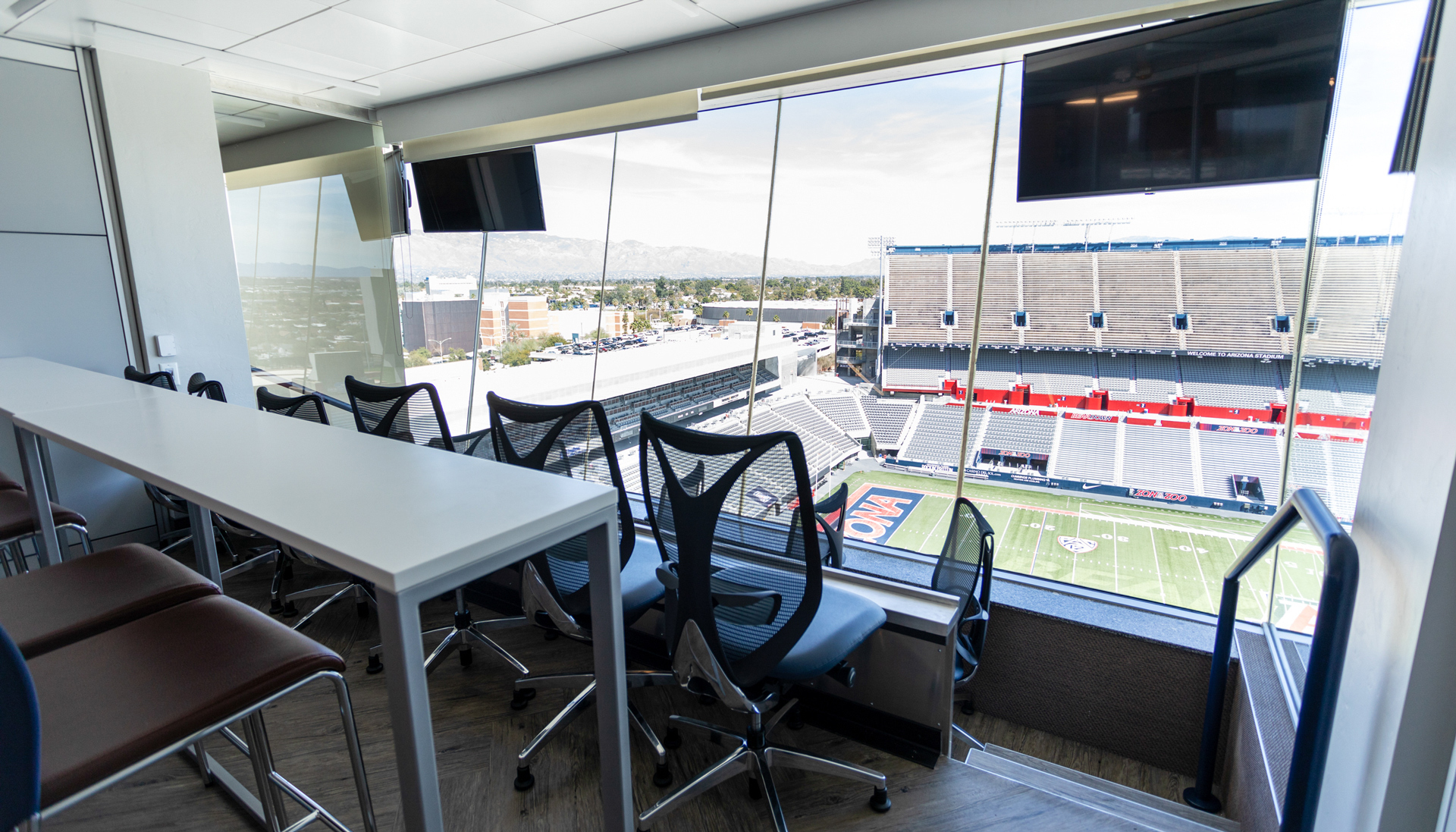 A look into the Skybox Suites at Arizona Stadium with downtown Tucson in view.