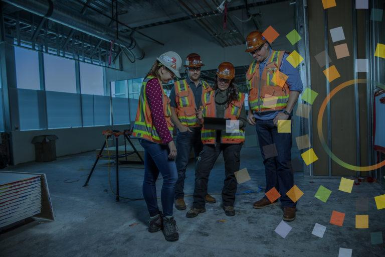 group of 4 workers on a jobsite looking at electronic tablet with overlay of construction inclusion logo