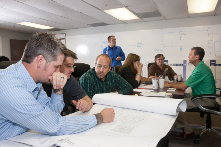 Employees review plans together.