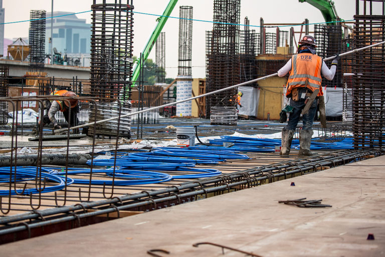 Workers on a jobsite during a concrete pour.
