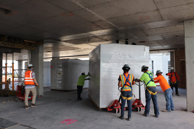 Workers moving materials on a jobsite.