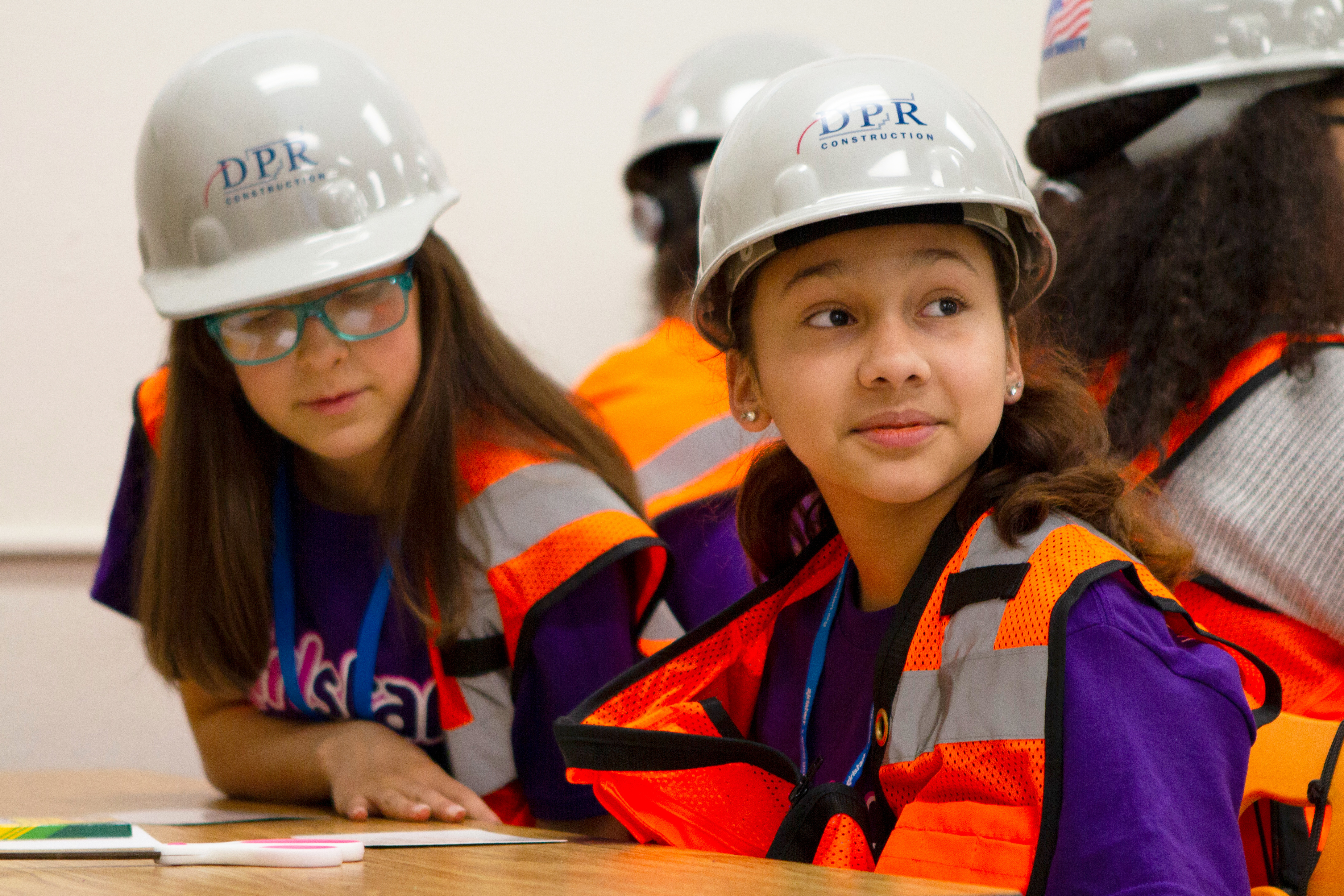 Kids in hard hats during a community event