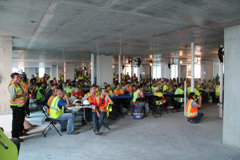 Teams listen to a safety meeting.