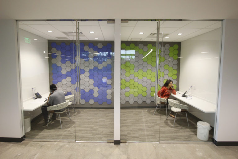 Meeting rooms with accent walls and glass fronts at DPR's Ft. Lauderdale office.