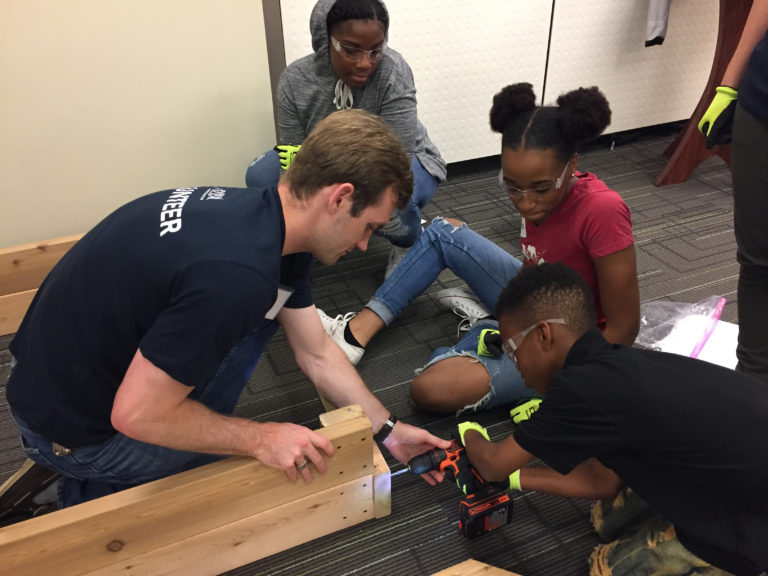 DPR Volunteer assisting children with power tools