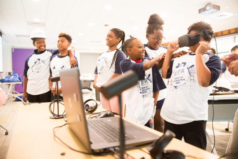 Children playing with a virtual reality head set