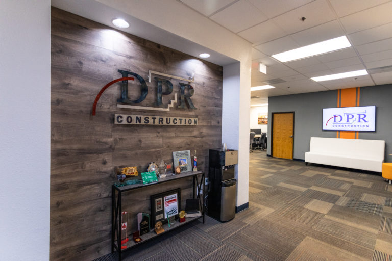 Entry hallway with DPR sign on a wood wall at DPR's Tucson office.