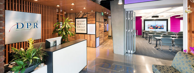 Lobby with wood detailing and meeting room at DPR's San Jose office.