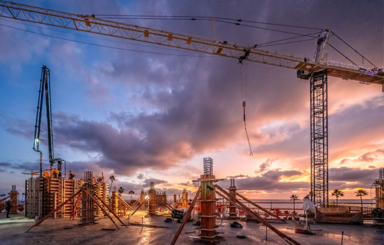 sunset on a jobsite with crane