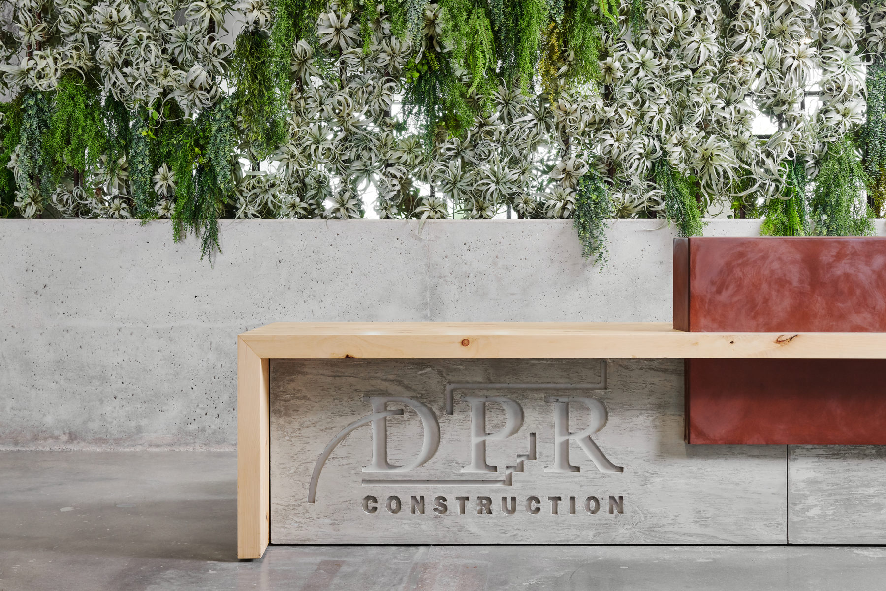 Mixed material DPR sign and living wall in DPR Austin.
