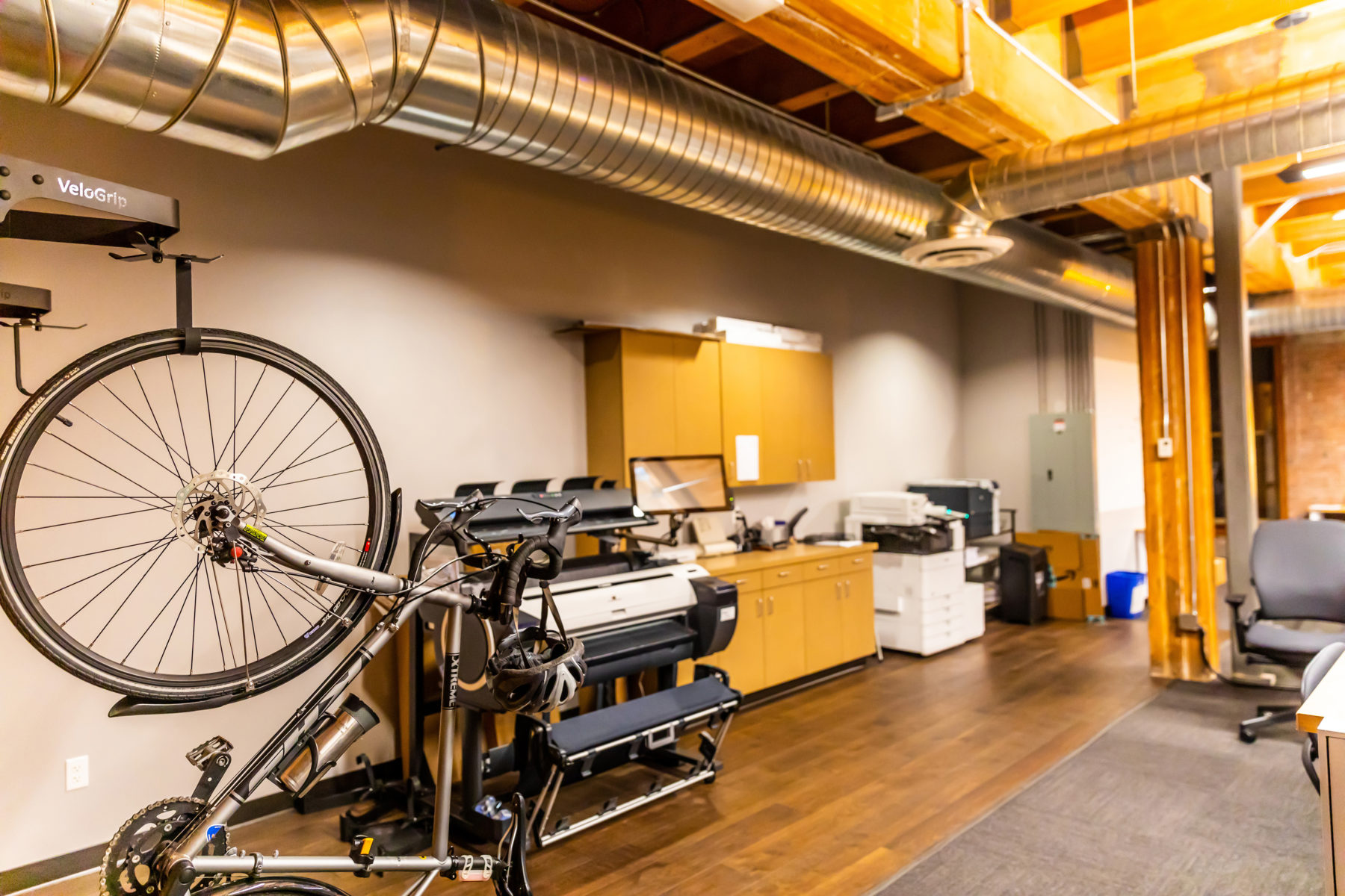 Office interior with a bike.