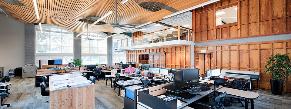 High ceiling with wood accents over workstations at DPR San Jose.