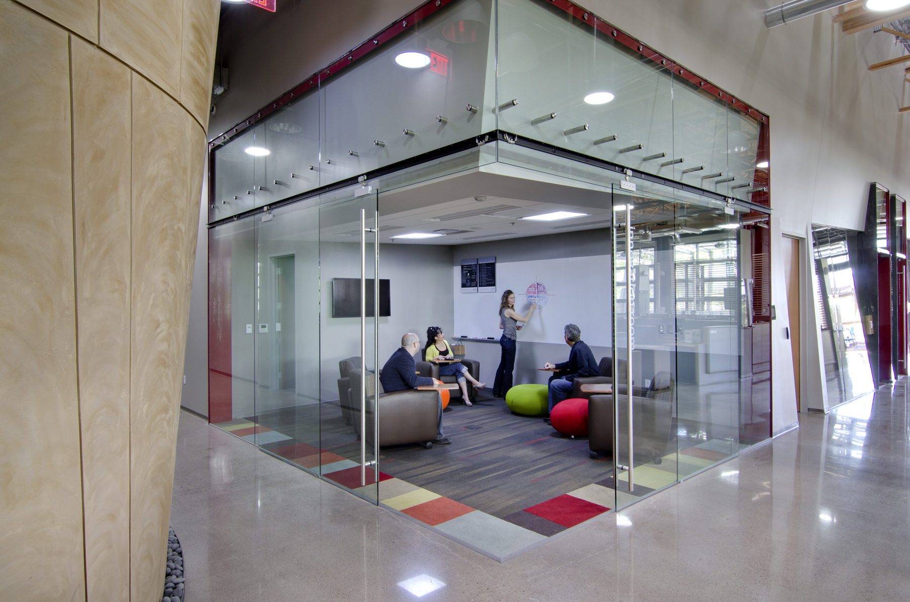 Corner glass conference room and hallway at DPR's Phoenix office.