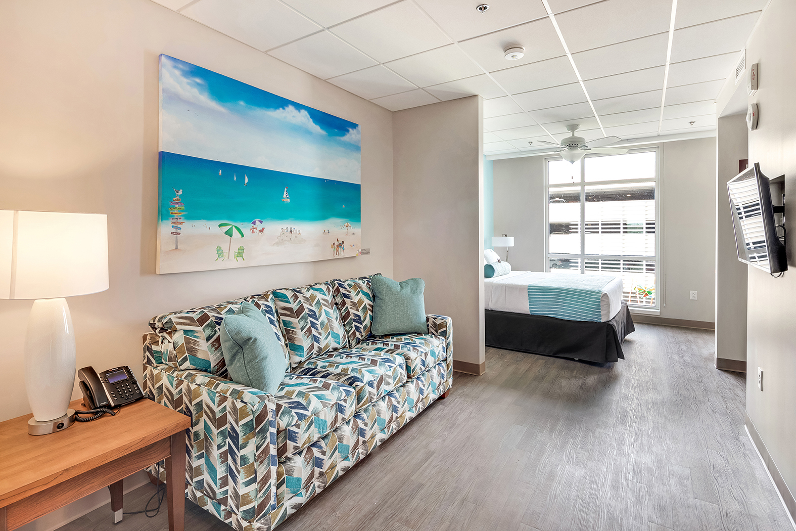 Patient suite with bed and sitting area