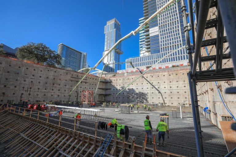 teams work to lay rebar and concrete