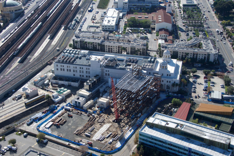 aerial view of the construction site with surrounding buildings