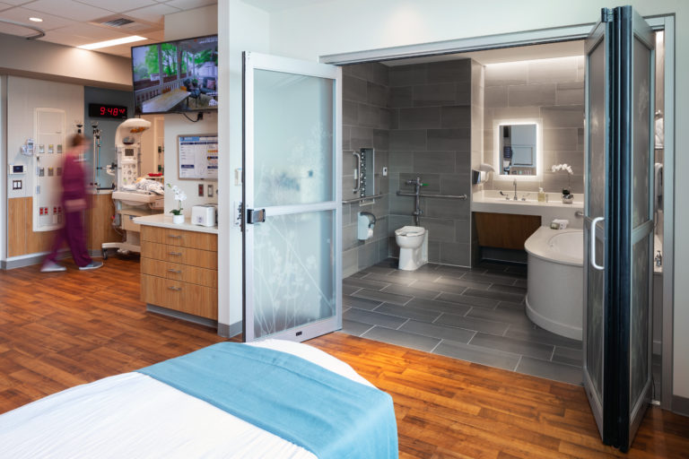 Interior shot of patient room and updated bathroom facility.