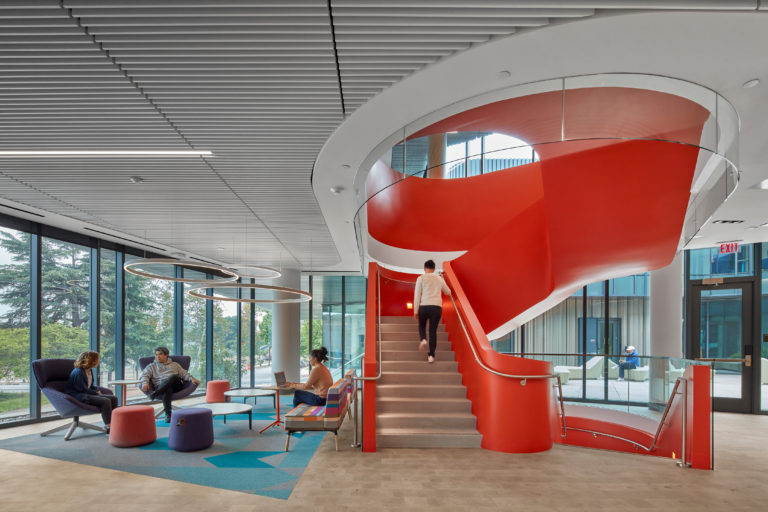 Orange interior staircase and student lounge