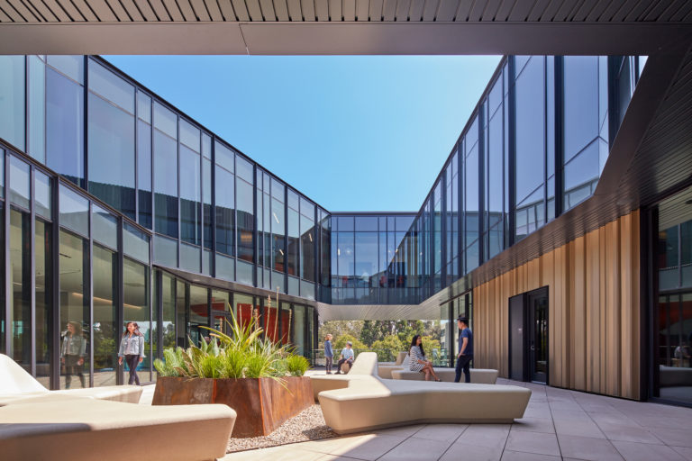 Interior courtyard of glass building with students